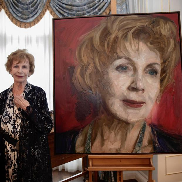 Edna O'Brien with her portrait by Colin Davidson