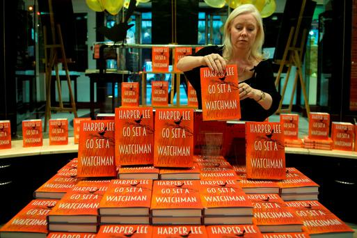 A staff member in Waterstones lays out the display of the first 'Go Set A Watchman' books before they went on sale this morning in Piccadilly in London