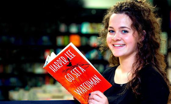Bookshop worker Kate Hanley (17) from Dunshaughlin, Co Meath, gets a peek at 'Go Set a Watchman', the new novel by Harper Lee, author of 'To Kill a Mockingbird', at Chapters Book Store in Parnell Street, Dublin. The book, which goes on sale today, has sparked huge interest