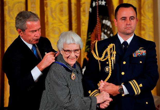 Then US President George W Bush awards the Presidential Medal of Freedom to Harper Lee in 2007. Photo: AFP/Getty Images