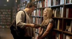 Thriller: Ben Affleck and Rosamund Pike browse books in the film adaptation of Gillian Flynn's Gone Girl