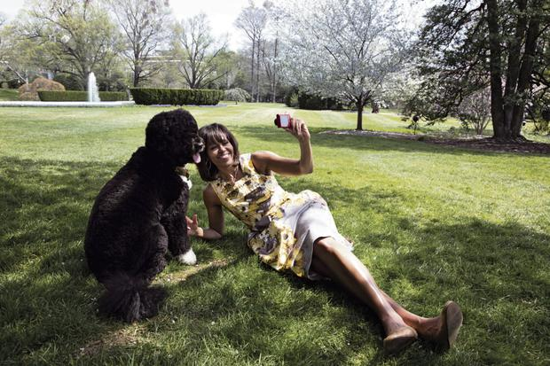 Kicking back: Michelle Obama on the White House lawn with Bo, the president's dog. Official White House Photo by Chuck Kennedy