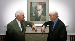 Honour: Benedict Kiely (right) and Arts Council chair Pat Murphy in 2001 with a portrait of Kiely by painter Stephen McKenna. Photo by Aidan Crawley