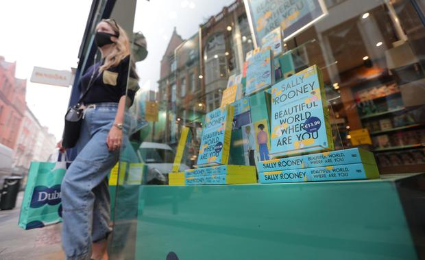 Sally Rooney, Beatutiful World Where Are You new book goes on sale.. A customer leaves Dubray books on Grafton Street with the new book. Picture; Gerry Mooney