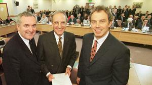 Diplomatic breakthrough: From left, Bertie Ahern, US Senator  George Mitchell and Tony Blair after the signing of the Good Friday Agreement in 1998