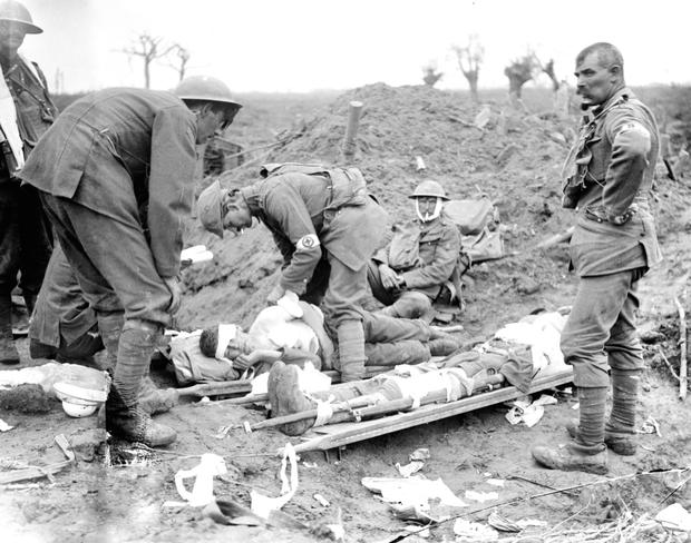 A doctor dressing the wounds of Lt Guy Morgan of the Irish Guards at the start of the Third Battle of Ypres in 1917 in this Imperial War Museum picture from Ireland and the First World War: A Photographic History, published by Mercier Press at €30