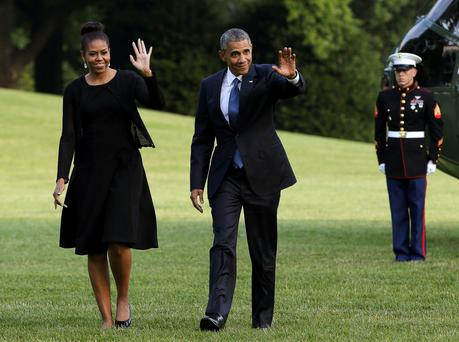 President Barack Obama and Michelle Obama return to the White House in Washington from Charleston, where they attended services for one of the nine people shot dead at an African Methodist Episcopal Church.