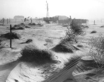 April 1938: A dust bowl farmstead in Dallam County, Texas, showing the desolation produced by the dust and wind on the countryside adding to the problems of the depression in the USA. (Photo by Three Lions/Getty Images)