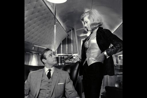 Girl power: Sean Connery as James Bond and Honor Blackman as Pussy Galore in the film version of Goldfinger