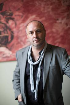 Attack: Colum McCann was punched from behind and knocked unconscious.