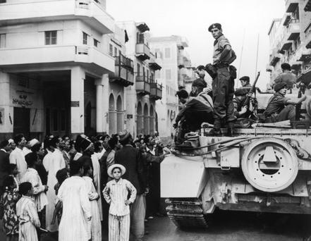 Suez Crisis: Egyptians crowd around a British tank in Port Said on November 12, 1956.