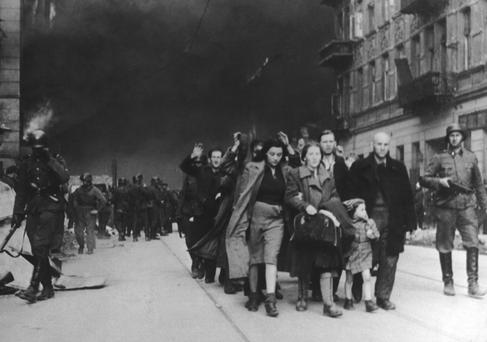Atrocities: Jewish civilians are forced to march by SS soldiers in the 1943 destruction of the Warsaw Ghetto in Poland.