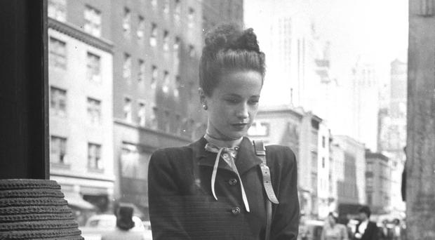 Lost in time: Maeve Brennan, while working for Harper's Bazaar, looking through a shop window. Photo: Nina Leen/Getty