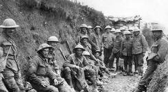 A moment of quiet on the Western Front: Members of the Royal Irish Rifles rest during the opening hours of the Battle of the Somme on July 1, 1916. Photo: Getty