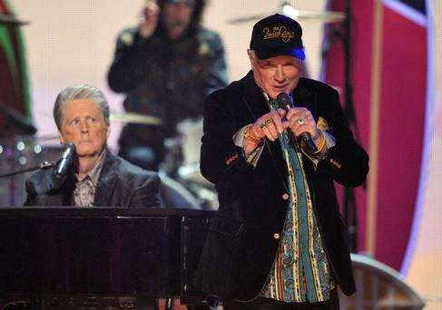 Wilson, Love and war: Cousins Brian and Mike performing at the Grammy Awards in 2012