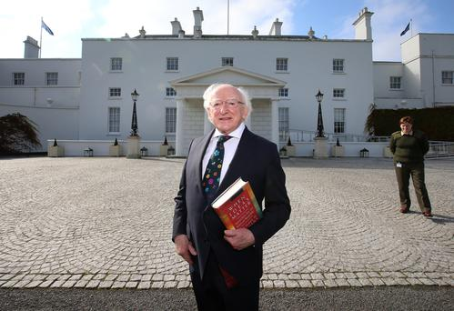 Thought-provoking: Michael D Higgins with his book of speeches outside Áras an Uachtaráin. Photo: Frank Mc Grath