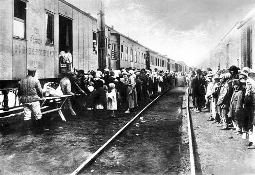 Life under the Gulag: Crowds gather beside a supplies train for starving Russians who had been deported to Siberia. Photo APIC/Getty Images