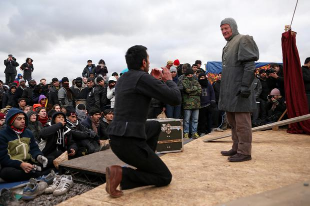 The play's the thing: Globe actors perform in the 'Refugee Jungle' in Calais, France, last April