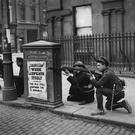 Taking cover: Free State soldiers fighting against Republican forces at O'Connell Bridge in Dublin during the Irish Civil War. Photo: Brooke/Topical Press Agency/Getty Images