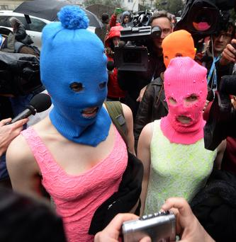 Masked: members of Russian punk group Pussy Riot, Nadezhda Tolokonnikova (left) and Maria Alyokhina (right) after release from questioning in February 2014.