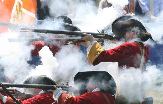 Muskets at dawn: The Battle of the Boyne, recreated here in Co Meath, saw the rise of the Protestant ascendency in Ireland. Photo: Niall Carson