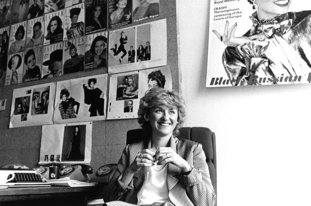 Taking cover: Tina Brown at the Tatler offices, London, Britain, 1983. Photo: Michael Ward/Getty Images