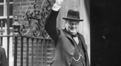 Winston Churchill gives the V sign outside Downing Street