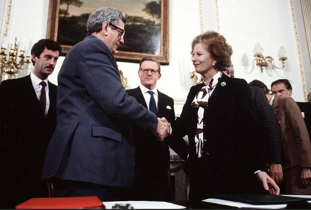 Garret FitzGerald and Margaret Thatcher sign the Anglo-Irish Agreement in 1985 with NI Secretary Tom King (centre) and Tánaiste Dick Spring (left)