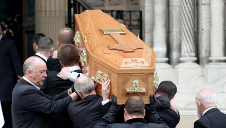Fitting send-off: The coffin of murdered journalist Lyra McKee was greeted with applause from mourners as it entered St Anne's Cathedral in Belfast