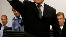 Monstrous acts: Mass killer Ander Behring Breivik makes a gesture as he arrives in court.