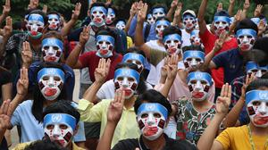 Social unrest: Protesters with masks stage a demonstration against the military coup in Yangon, Myanmar in April