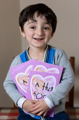 Adam King Hugging his Virtual Hug Valentines Cards. Photo: Shaunagh O'Connell Photography.