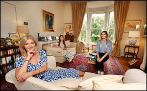 Entrepreneur Noelle McCarthy in her sitting room with her two daughters, Aifric, on the left, and Zoe. The sofas are from The Sofa Factory. The painting over the sofa is by John Connors