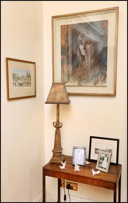 A detail of the living room. The portrait of Noelle is by Cian McLoughlin, who specialises in work related to the theatre; Noelle also has one of his works depicting Michael Gambon as Hamm in Beckett's Endgame