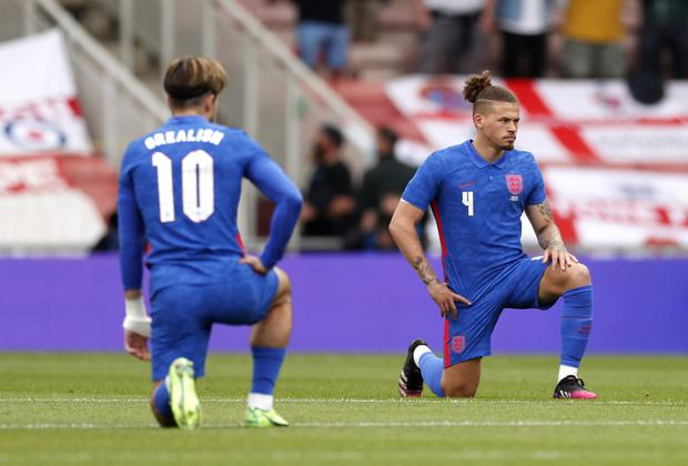 England's Jack Grealish and Kalvin Phillips take the knee before the international friendly match at the Riverside Stadium, Middlesbrough (Lee Smith/PA)