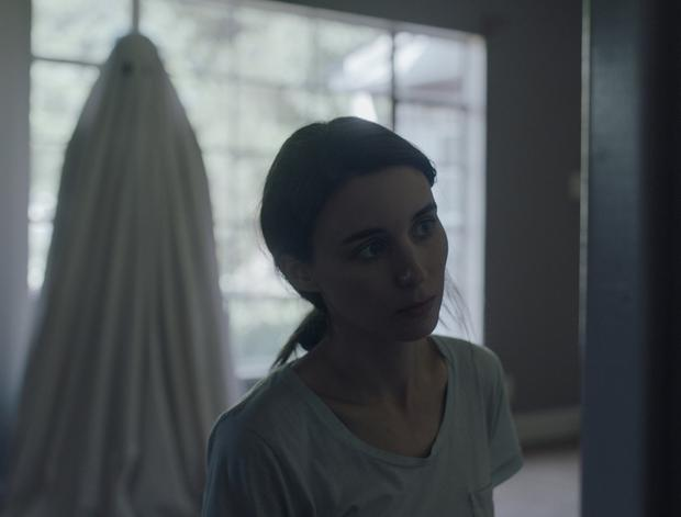 Where the sheets have no name: Rooney Mara (pictured) is haunted by her dead partner Casey Affleck who is trapped in their house as a ghost