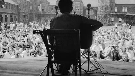 Bob Dylan playing at the Newport Folk Festival in Rhode Island in July 1963. Some years earlier, he had seen The Clancy Brothers play in a pub in Manhattan and the group would have a profound effect on him.