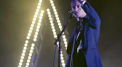 Alex Turner from Arctic Monkeys on stage at the Electric Picnic last night