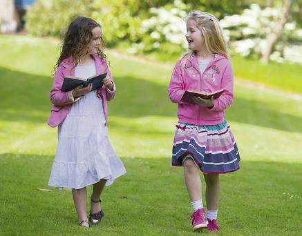 Pictured at Lismore Castle Gardens are book enthusiasts Emily Kate O'Neill (6) and Amelia Jane Feeney (7) launching the programme for the Immrama Festival of Travel Writing which will take place in Lismore, Co. Waterford from June 12 to 15. Picture: Patrick Browne
