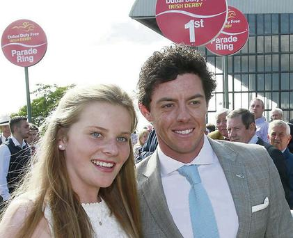 Golfer Rory McIlroy poses with Elizabeth Collins