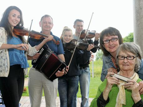 All-Ireland winner Mary Moynihan (83), her children Padraig and Margaret with grandchildren, Cliona Creedon, Sinead Moynihan and Padraig Creedon (all All-Ireland champions) get set for the Munster Fleadh Cheoil in Killarney. Picture: Don MacMonagle