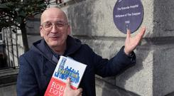 Author Roddy Doyle unveils a plaque at the Rotunda Hospital (the birth place of The Snapper) for the launch of the One City One Book 2015 programme