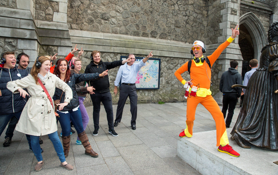 Disco divas: Guru Dudu leads his followers around Dublin city centre. Photo: Arthur Carron