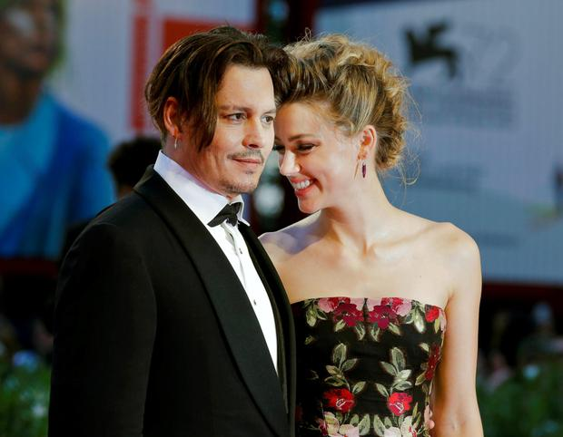 DEPP TROUBLE: Johnny Depp and Amber Heard arrive at the premiere of the film 'The Danish Girl' at the Venice Film Festival in 2015 in happier times.