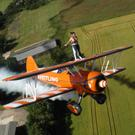 Something in the air: Deirdre Reynolds braves the wingwalk at 500ft at the Breitling Wingwalkers base in Gloucestershire