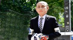 Vlad to see you: An activist dresses up as Putin ahead of the World Cup. Photo: AFP/Getty Images
