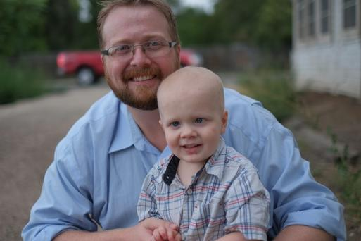 Games console: Developer Ryan Green with his son Joel, who died from cancer in March 2014.