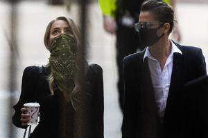 Amber Heard, left, arriving at the High Court (Victoria Jones/PA)