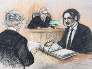 Court artist sketch by Elizabeth Cook of actor Johnny Depp (right) being cross-examined by Sasha Wass QC (left) (Elizabeth Cook/PA)