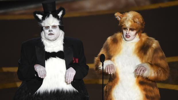 James Corden, left, and Rebel Wilson present the award for best visual effects at the Oscars (Chris Pizzello/AP)